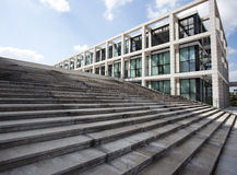 Up stairs in front of modern office building Stock Images