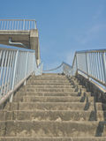 Up stairs on to overpass. Look up view of up stairs on to overpass under blue sky Stock Photos