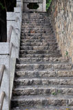 Up strait stair. Aged stone and concrete made stair up strait, with hand post and rail, shown as aged color and texture and up strait position Stock Images