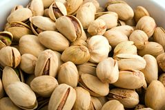 up täta jordnötter för bunke white Arkivfoton