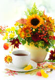 Up of tea and autumnal flowers