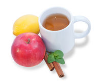 Cup of tea with fruit, cinnamon and mint isolated Stock Photography