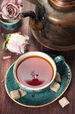 Сup of tea and a vintage teapot Stock Images
