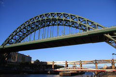 Up to the Bridge. The Tyne Bridge viewed from Newcastle quayside. Spanning the River Tyne between Gateshead and Newcastle upon Tyne. The Swing, and High Level Stock Photos