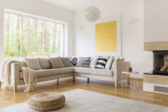 Up-to-date design of lounge. Up-to-date design of cozy spacious lounge with white sofa and carpet stock photo