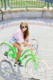 Up view of a beautiful happy girl on a bike Royalty Free Stock Photo