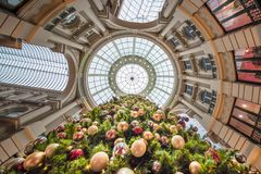 Up view of a Christmas tree with its shiny decorative balls in a. Multi-color, form and size, in the oldest shopping mall in The Netherlands Royalty Free Stock Image