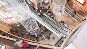 Up view people in the shopping mall. Top view of people riding escalators and looking around stock video