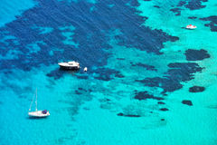 Up view of sea water and boats Stock Images