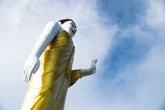 Up view Standing Buddha and raise the right hand. Stock Photo