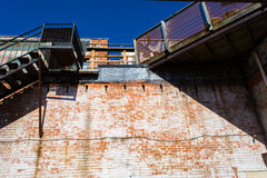 Up the wall. Looking up the side of a red brick wall Royalty Free Stock Image