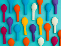 Up this way. Arranged pattern of colorful deflated balloons on a blue background Stock Photo