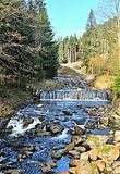 Upa river above Pec pod Snezkou in Krkonose mountains. Upa river with few cascades and clear sky in Krkonose mountains above Pec pod Snezkou Stock Photos