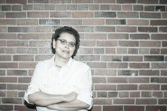 Upbeat Breast Cancer Survivor In Work Environment. Upbeat Latina Breast Cancer Survivor In Work Environment Stock Photography
