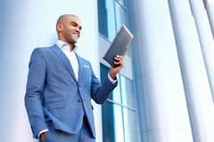 Upbeat businessman standing near column Royalty Free Stock Images