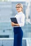 Upbeat businesswoman holding laptop Royalty Free Stock Image