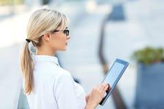 Upbeat businesswoman holding laptop Stock Photos