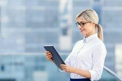 Upbeat businesswoman holding laptop Stock Photo
