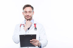 Upbeat doctor holding the folder Royalty Free Stock Photo