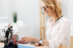 Upbeat engineering specialist testing robot in the lab Stock Photo