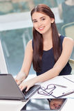Upbeat girl sitting with laptop Stock Images