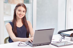 Upbeat girl sitting with laptop Royalty Free Stock Images