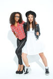 Upbeat girls posing at the camera Royalty Free Stock Photography