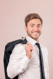 Upbeat lawyer holding jacket on shoulder Royalty Free Stock Photos