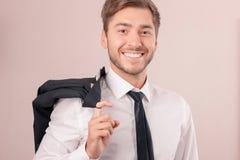 Upbeat lawyer holding jacket on shoulder Royalty Free Stock Photo