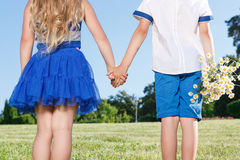 Upbeat little kids holding theur hands together Royalty Free Stock Image