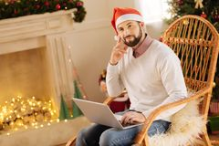 Upbeat man thinking about gift ideas stock images