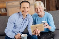 Free Upbeat Mother And Son Posing While Looking At Old Photo Stock Photo - 105312920