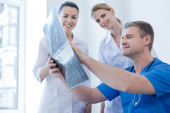 Upbeat radiologists examining ct scan in the medical lab Royalty Free Stock Photos