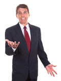 Upbeat Salesman. Middle aged businessman smiling and gesticulating with his hands Stock Image