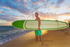 Upbeat Surfer at Sunset Stock Photo