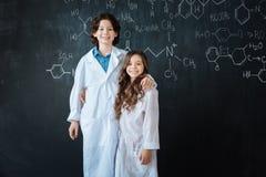 Upbeat teenagers enjoying medicine lesson at school stock image