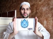 UPC Broadband logo. Logo of UPC Broadband on samsung tablet holded by arab muslim man. UPC Broadband is a pan-European telecommunications company owned by royalty free stock images