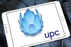 UPC Broadband logo. Logo of UPC Broadband on samsung tablet. UPC Broadband is a pan-European telecommunications company owned by Liberty Global and is active in stock photo