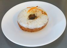 A Cream Cheese Iced Carrot Cake Doughnut stock images