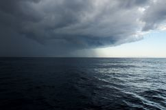Upcoming storm in the sea. Rain stock photography