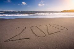 2020 new year on idyllic beach at sunny day stock images