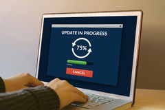 Update concept on laptop computer screen on wooden table Stock Photos