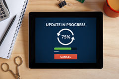 Update concept on tablet screen with office objects Stock Photo