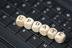 Update. Keyboard and wood dice with the word Update royalty free stock images