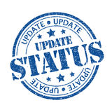 Update status. Blue color update status rubber stamp Stock Photos