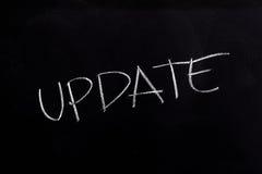Update Text on Blackboard. Handwritten chalk text Update on the blackboard royalty free stock image