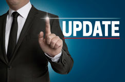 Update touchscreen is operated by businessman Stock Images