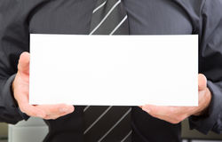 Update your company! Body part of a man holding a sign board Stock Photography