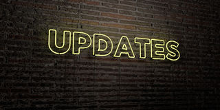 UPDATES -Realistic Neon Sign on Brick Wall background - 3D rendered royalty free stock image Stock Photos