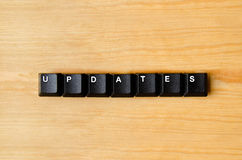 Updates word. With keyboard buttons Royalty Free Stock Photo